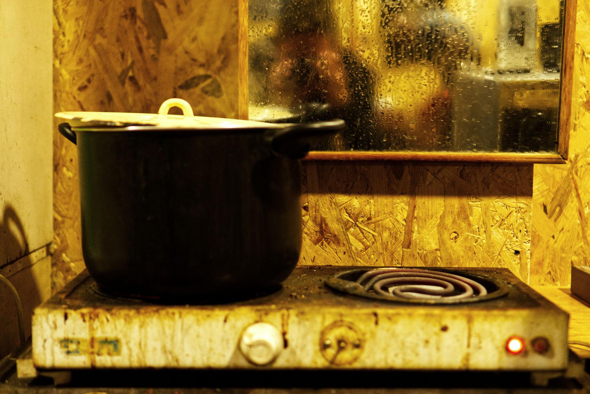 Food cooking at Kosmo Station.