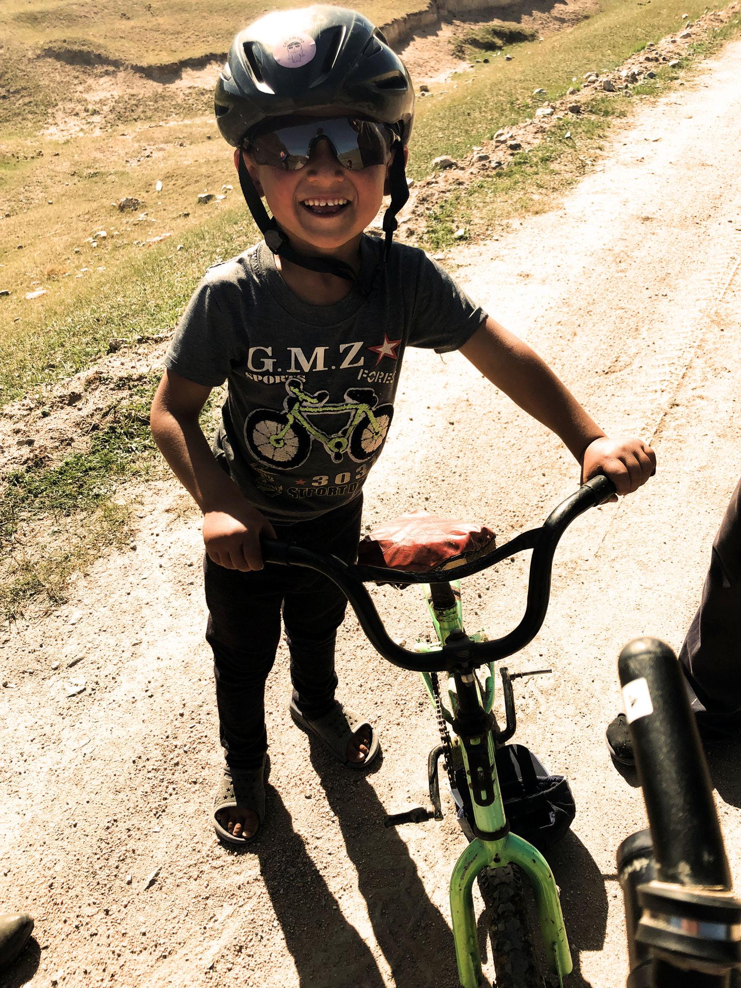 A kid with a MET helmet.